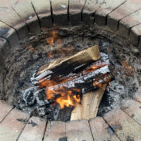 Fire burning in Houston outdoor fireplace